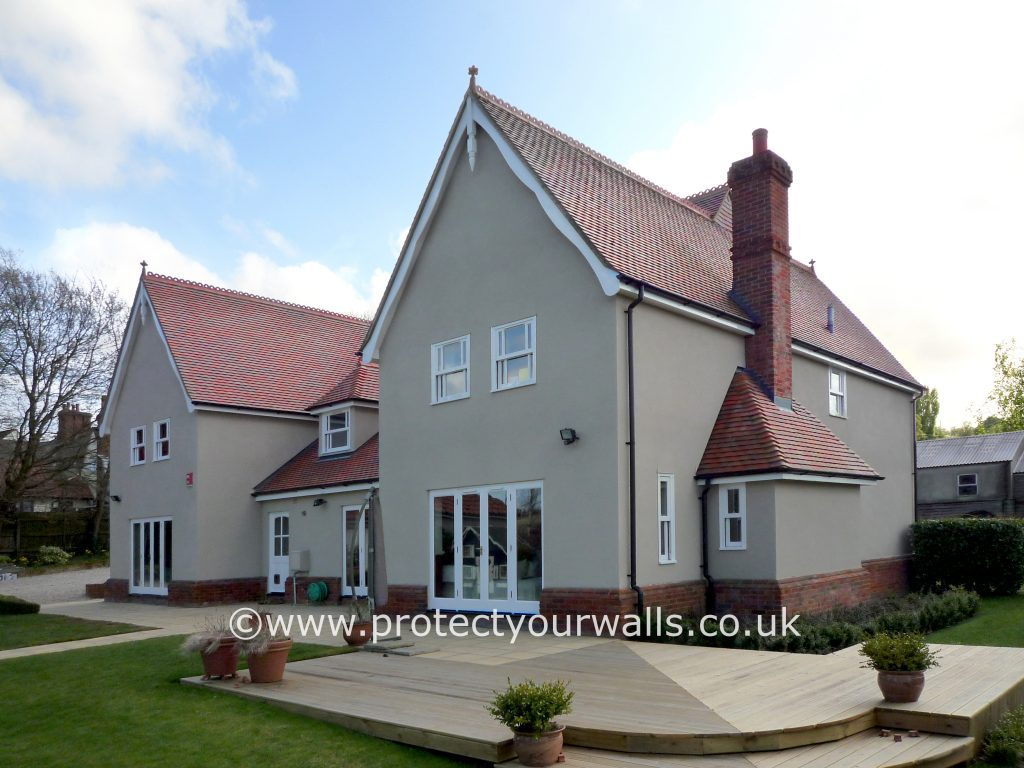 Freshly rendered house, Essex - front view with decking.