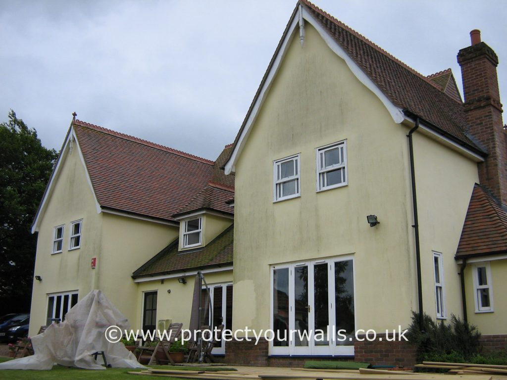 House in need of rendering, Essex - rear view.